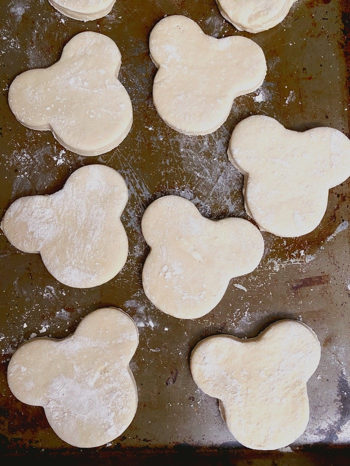 Mickey Beignet dough cut out on a baking sheet